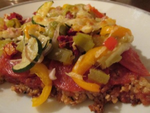 Gluten-free pizza with brown rice crust. I love pepperoni and green chiles on my pizza!